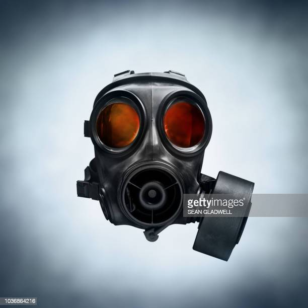 black military gas mask - gas mask stock pictures, royalty-free photos & images