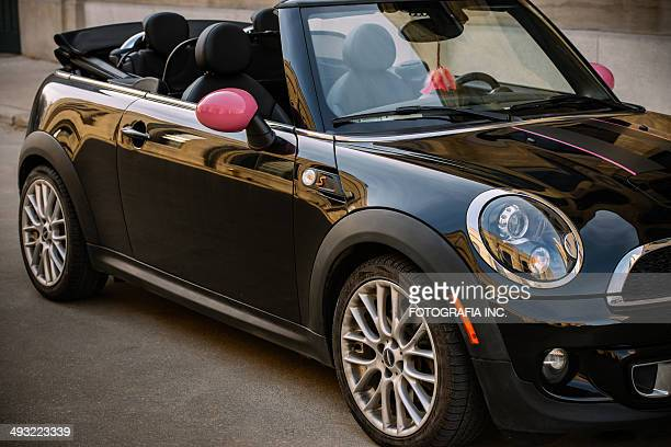 black mini convertible in spring time - mini cooper stock pictures, royalty-free photos & images