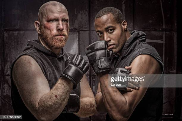 black mma fighter and white redhead male - fighter stock pictures, royalty-free photos & images