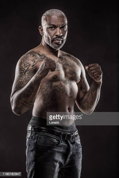 black mma fighter shadow boxing - combat sport stock pictures, royalty-free photos & images