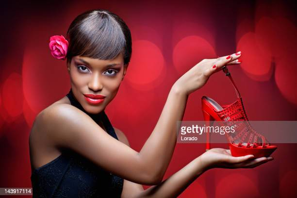black model showing red shoe