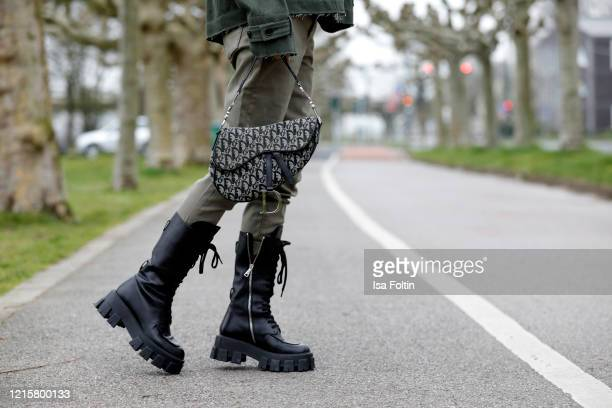 Black monolith boots by Prada and a Dior saddle bag as a detail of influencer Gitta Banko during a street style shooting on March 20, 2020 in...