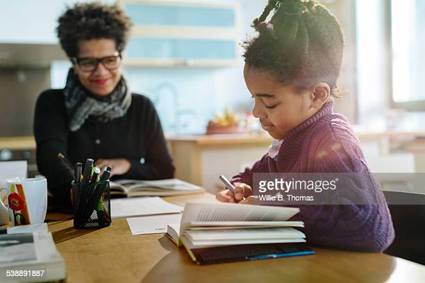 Black Mother and Child working at Table
