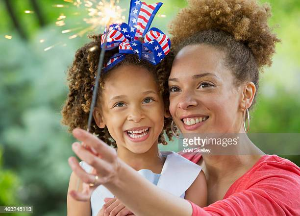 black mother and daughter celebrating 4th of july - fourth of july stock photos and pictures