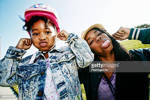 black mother and daughter making faces - funny black girl ストックフォトと画像