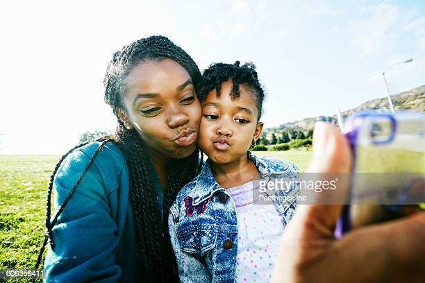 black mother and daughter taking selfie outdoors - funny black girl ストックフォトと画像