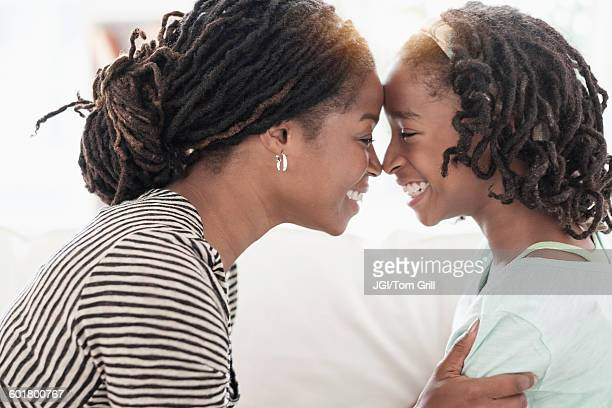 black mother and daughter touching noses - funny black girl stock photos and pictures