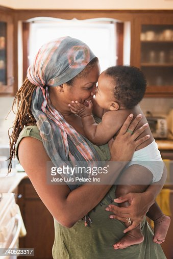 Black mother hugging baby son