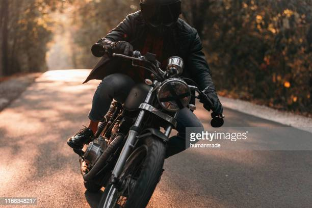 black motorcycle driver - motorcycle stock pictures, royalty-free photos & images