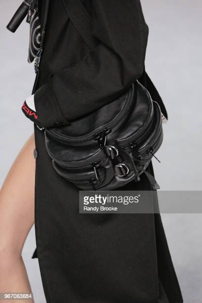 A black multi zippered pocket fanny pack detail during the Alexander Wang Resort Runway show June 2018 New York Fashion Week on June 3 2018 in New...