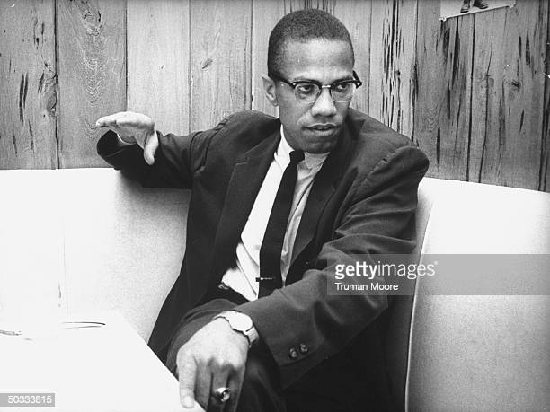 Black Muslim Ldr Malcolm X explaining why he is quitting the sect during interview at restaurant