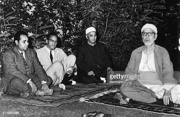Black Muslim leader Malcolm X meets with Sheik Abdel Rahman Tag the future rector of Al Azhar the only Muslim University in the world