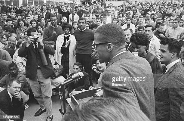Black Muslim leader Malcolm X speaks to a crowd at the University of Hartford in Connecticut. The talk was moved outdoors when attendance at the talk...