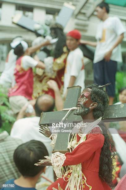 Black Nazarene icon sits among the crowd of over 200000 before the procession of Quiapo Churchs Black Nazarene January 9 2002 in the center of Manila...