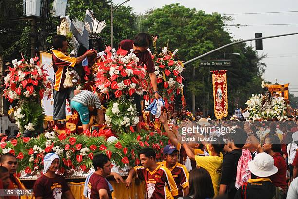 Black Nazarene replicas join the parade of millions of Catholic devotees converging in Quiapo for the 406th feast of The Black Nazarene on January 9...