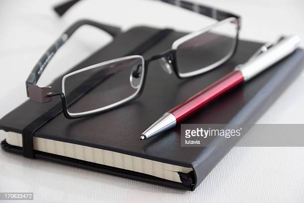 black notebooks with pen and glasses - lutavia stock pictures, royalty-free photos & images