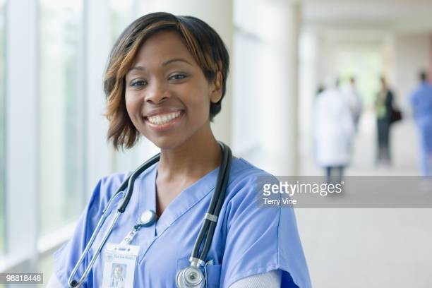 Black nurse in hospital hallway