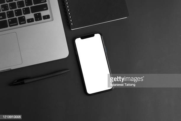 black office desk table with laptop,smartphone and supplies. top view with copy space, flat lay. - iphone mockup stock pictures, royalty-free photos & images