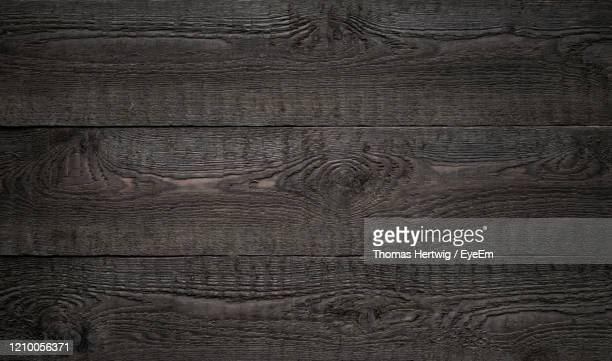black old wood striped texture or background - legno foto e immagini stock