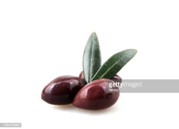 black olive fruits isolated on white background - olijf stockfoto's en -beelden
