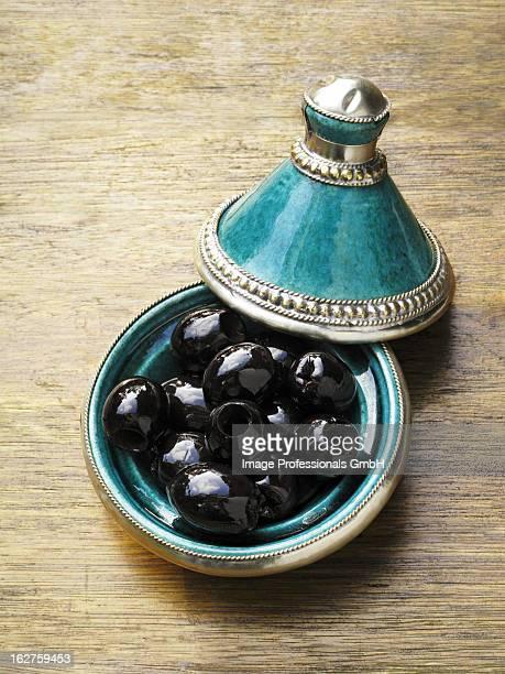 Black olives in tajine shaped dish