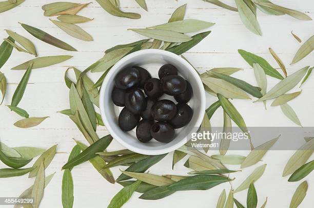 Black olives with leaves, close up