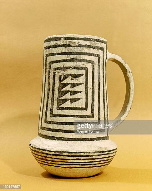 A black on white pitcher The geometric design can be traced back to earlier basketry USA Anasazi Pueblo period c 1000 AD