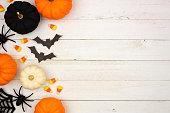 Black, orange and white Halloween side border over white wood