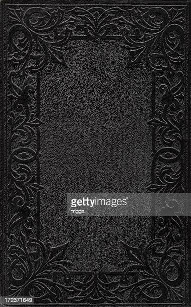 A black ornately embossed book cover
