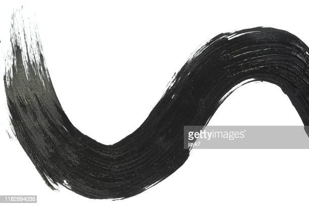 black paint stroke - stroking stock pictures, royalty-free photos & images