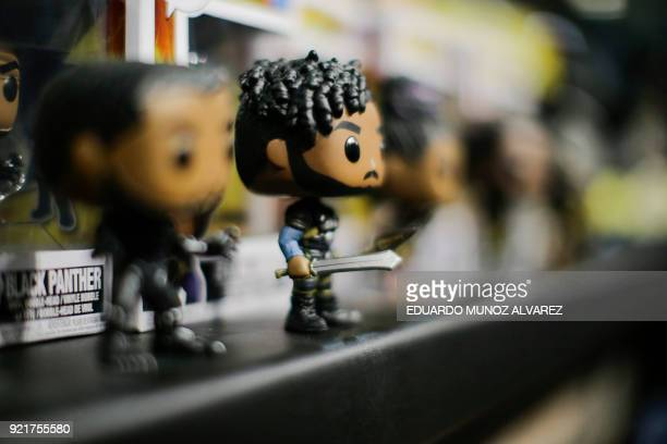 Black Panther bobble head dolls are displayed during the annual New York Toy Fair at the Jacob K Javits Convention Center on February 20 in New York...
