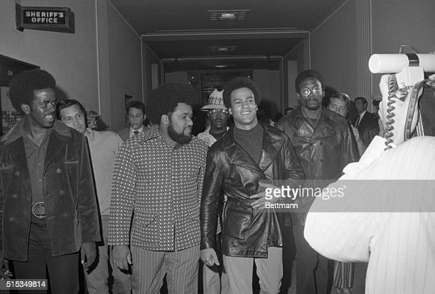 Black Panther chief Huey Newton is escorted by his bodyguard Robert Bay as they arrive at court for Newton's third manslaughter trial Newton's...