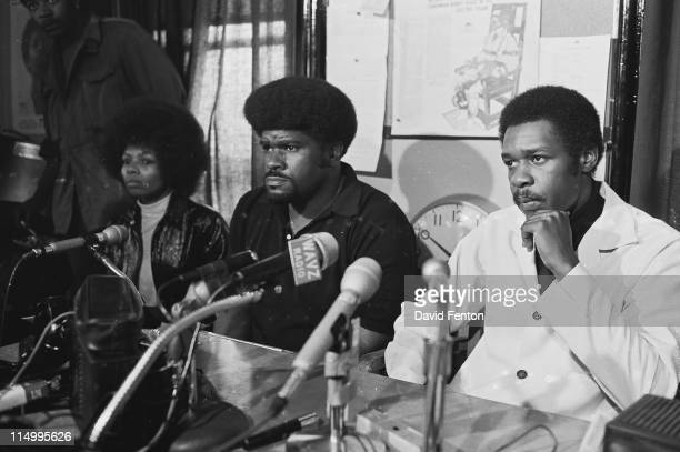 Black Panther Deputy Minister of Information Elbert 'Big Man' Howard center and Black Panther Chief of Staff David Hilliard right hold a press...