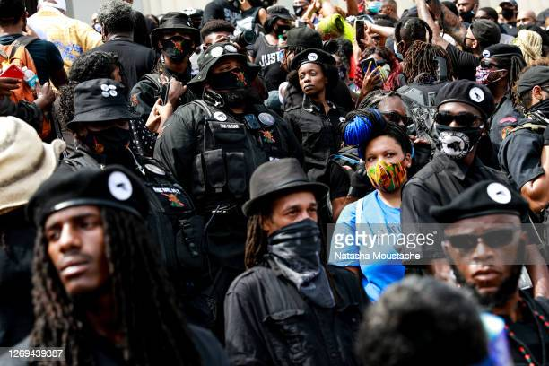 Black Panther members stand at attention on the steps of the Lincoln Memorial during the Commitment March on August 28, 2020 in Washington, DC. Rev....