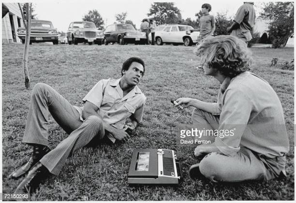 Black Panther Party cofounder Huey P Newton reclines on the grass as he answers questions from a Liberation News Service reporter on the campus of...
