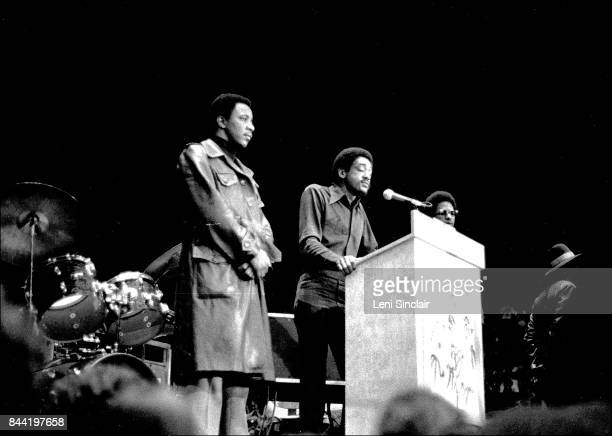 Black Panther Party Leader Bobby Seale speaking at podium on stage at the John Sinclair Freedom Rally at the Crisler Arena surrounded by bodyguards...