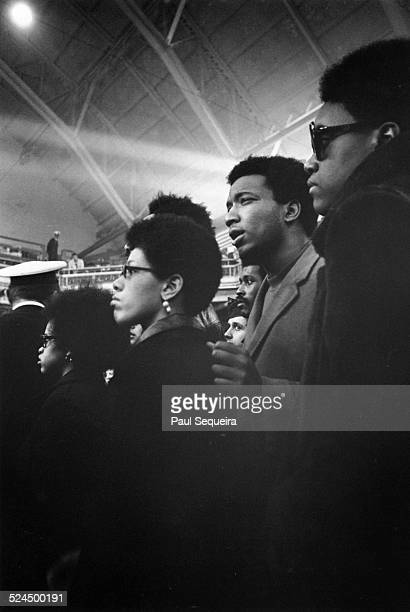 Black Panther Party leader Fred Hampton second from right attends a peace rally with friends at the Chicago Coliseum Chicago Illinois April 1969
