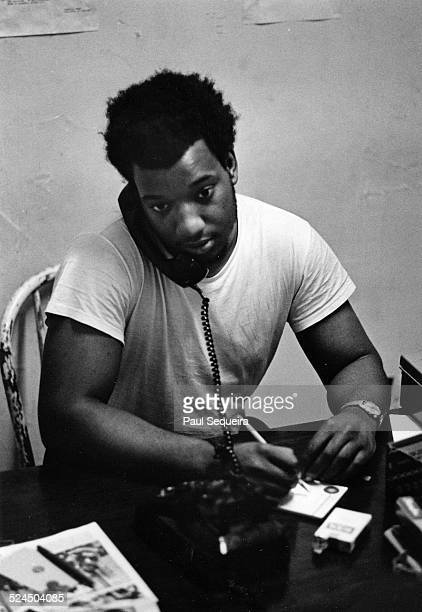 Black Panther Party leader Fred Hampton speaks on the telephone while at Panther Headquarters on 2350 West Madison Avenue Chicago Illinois 1969