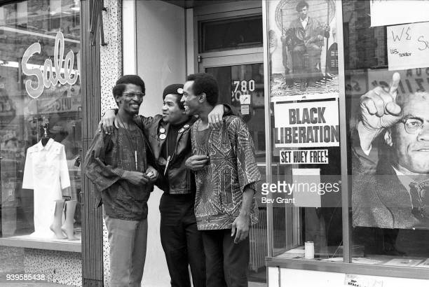 Black Panther Party Minister of Defense Joudan Ford shares a laugh with a pair of unidentified men in the doorway of the group's office , Brooklyn,...
