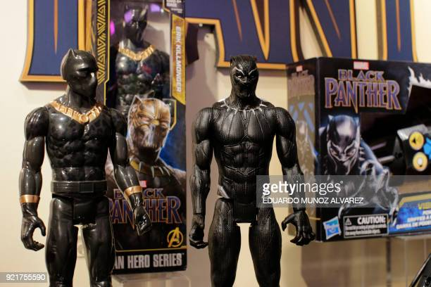 Black Panther toys are displayed to attendees at the Hasbro showroom during the annual New York Toy Fair on February 20 in New York Panther claws...