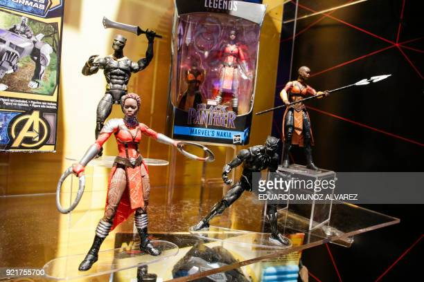 Black Panther toys are displayed to attendees at the Hasbro showroom during the annual New York Toy Fair, on February 20 in New York. Panther claws,...