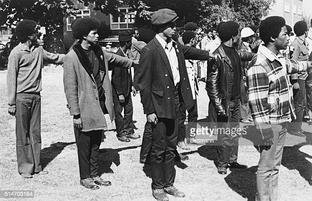 Black Panthers line up in paramilitary formation at a panthersponsored AntiFacist rally in Oakland California