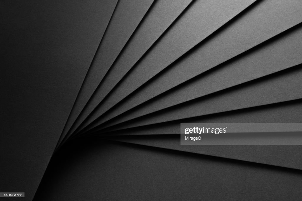 Black Paper Fan Shaped Stacking : Stock Photo