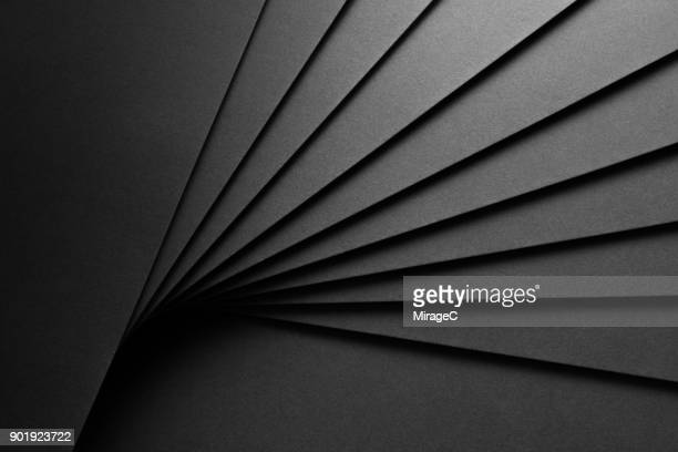 black paper fan shaped stacking - black color stock pictures, royalty-free photos & images