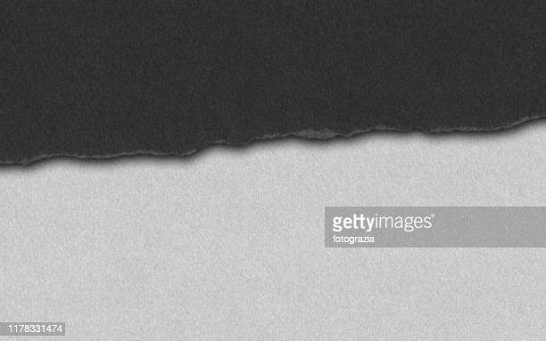 black paper tear - tear stock pictures, royalty-free photos & images