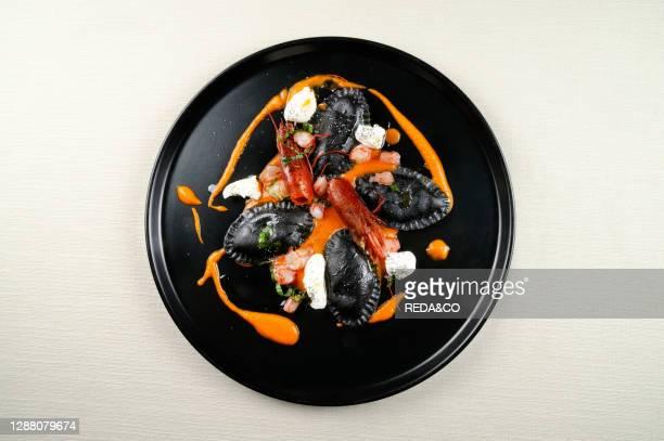 Black pasta tortelloni. Basil burrata. Mazara del Vallo red prawn and tomato coulis.