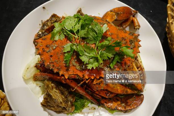 black pepper crab, local and famous seafood in singapore - chilli crab stock photos and pictures