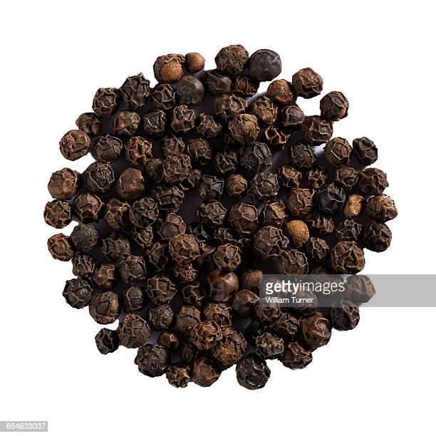Black peppercorns in a circle