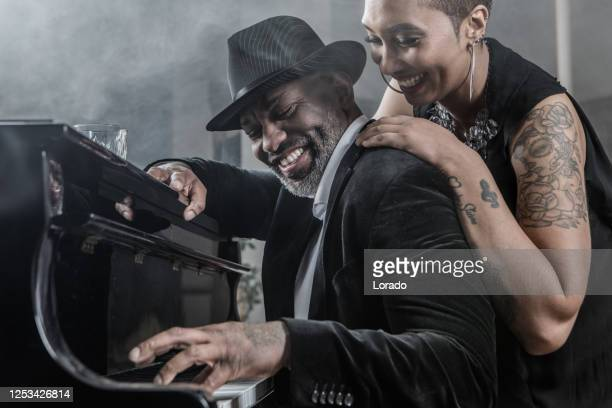 black piano playing man and beautiful soul singer black woman - musician stock pictures, royalty-free photos & images
