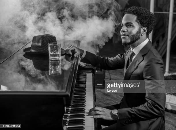 black piano playing man - jazz stock pictures, royalty-free photos & images